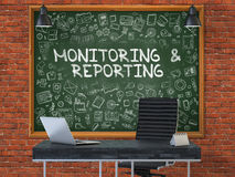 Monitoring and Reporting on Chalkboard in the Office. 3D. Green Chalkboard with the Text Monitoring and Reporting Hangs on the Red Brick Wall in the Interior of Stock Images