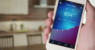 Monitorować władzy użycie w domowym używa smartphone app zdjęcie wideo