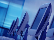 Monitors. Computer room in a blue tone Royalty Free Stock Photography