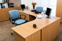 Monitors on a desk Stock Images