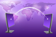 Monitors with world map on purple stock photography