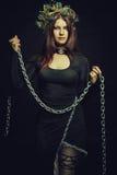 Monja con las cadenas Foto de archivo libre de regalías