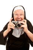Monja divertida con la cámara Fotografía de archivo libre de regalías