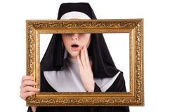Monja joven con el marco Imagen de archivo libre de regalías