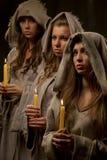 Monjas praing con las velas Foto de archivo libre de regalías