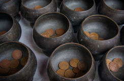 Monk's alms bowl and Thai coin donated. Royalty Free Stock Photos