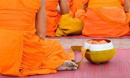 Monk with alms bowl Stock Photos