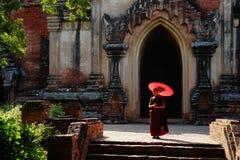 Monk in Bagan, Myanmar. Monk with unbrella in Bagan, Myanmar Royalty Free Stock Images