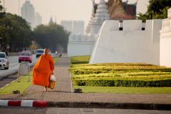 Monk. Bangkok, Thailand - February 7, 2015 : Monk buddhism walking for receive food in morning near Wat Phra Kaew ( the Temple of the Emerald Buddha stock image