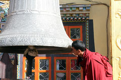 Monk and bell Stock Photography