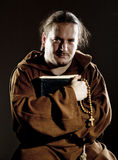 Monk with bible and rosary Royalty Free Stock Photo