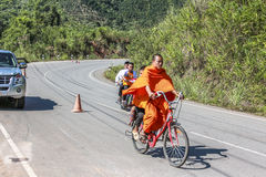Monk with bicycle Royalty Free Stock Photos