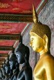 Monk black and golden image of Buddha Stock Image