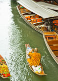 Monk on a boat at floating market, Thailand Royalty Free Stock Photo