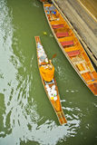 Monk on a boat at floating market, Thailand Stock Images