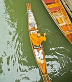 Monk on a boat at floating market, Thailand Stock Photos