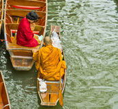 Monk on a boat at floating market, Thailand Stock Photography