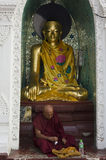 A Monk and the Buddha Royalty Free Stock Photography