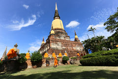 Monk and Buddha statue Royalty Free Stock Photos