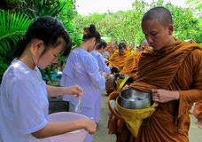 Monk in buddhism receiving food Royalty Free Stock Photo