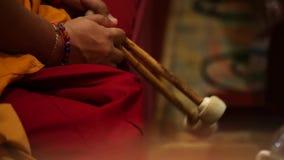 Monk on buddhist drum. With chopsticks stock video footage