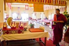 Monk and candles, Gyuto monastery, Dharamshala, India Royalty Free Stock Image