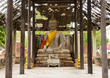 Monk care yellow robe of buddhist statue Royalty Free Stock Image