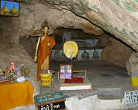 Monk cave in Thailand Stock Photo