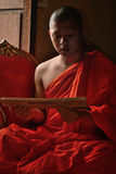 Monk chant mantra in front of buddha in Chiangmai, Thailand. CHIANGMAI, THAILAND - OCT 1 2015 : Everyday very early in the morning, Monk chant mantra in front of Stock Photos