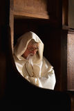 Monk in choir seat Stock Photos