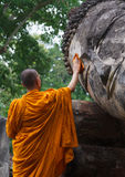 Monk is cleaning Buddha statue Royalty Free Stock Photography