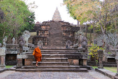 Monk climbing up stairs at Pranom Rung Stone Clastle, Buriram,Thailand Royalty Free Stock Photography