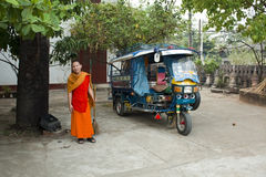 Monk with colorful Tuk Tuk in Laos, Luang Prabang Stock Images