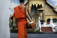 Monk coming back in temple Stock Photo