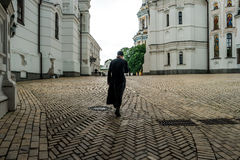 Monk crossing himself in the yard of Kyiv Pechersk Lavra Stock Images
