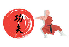 Monk demonstrating Kung Fu and a hieroglyph. Royalty Free Stock Photos