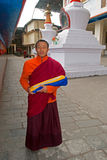 Monk at Do Drul Chorten Stupa. A Buddhist monk holding a copy of Buddhist manuscript in hand at Do Drul Chorten Stupa at Sikkim, India Royalty Free Stock Images