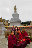 Monk at Do Drul Chorten Stupa. A group of apprentice Buddhist monk with their copy of Buddhist manuscript at Do Drul Chorten Stupa at Sikkim, India Stock Photos