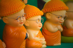 Monk doll meditating to luminosity. Of public front of small shop royalty free stock photos