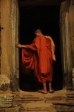 Monk in Doorway Stock Photo