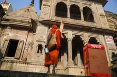 A monk is entering a temple near the Ganges river, India royalty free stock photography