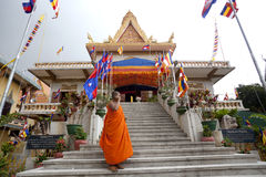 Monk at the entrance of monastery Stock Photo