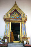 Monk at the entrance to the wat Stock Images