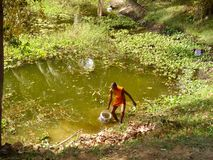 Monk fetching water Royalty Free Stock Images