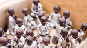 Monk figurines with blur effect Royalty Free Stock Photo
