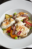 Monk fish and vegetables Stock Image