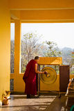 Monk and gong, Gyuto monastery, Dharamshala, India Royalty Free Stock Photography