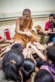 Monk Handing Towards Kids Royalty Free Stock Photo