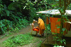 Monk has head shaved at Wat Tam Seu-uh, Krabi, Thailand. Royalty Free Stock Images
