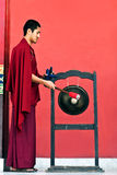 Monk hitting the Gong Stock Photography